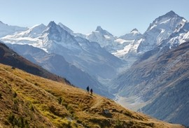 Hiker on Swiss trails in the Alps