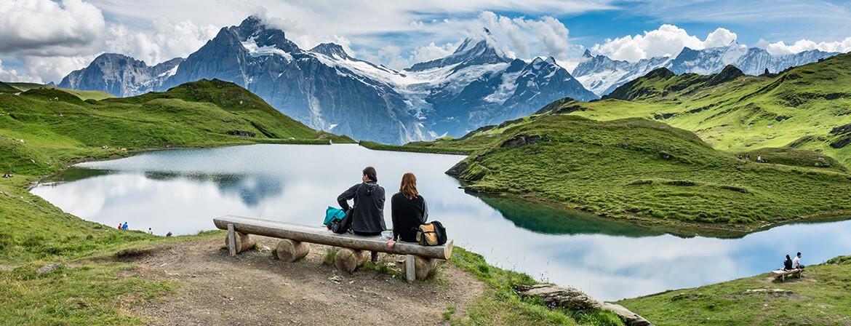 Hikers resting at Bachalpsee Lake