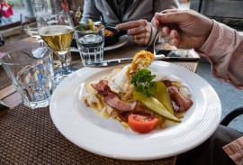 A fancy rösti or röschti dinner plate can be heaped with potatoes, egg, bacon, tomato and pickles in the Lauterbrunnen village