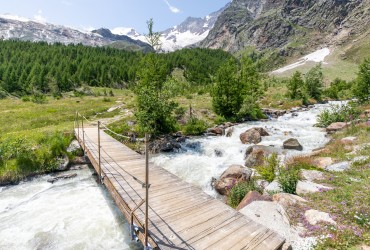 Water crossing on a summer day hiking in Saas-Fee