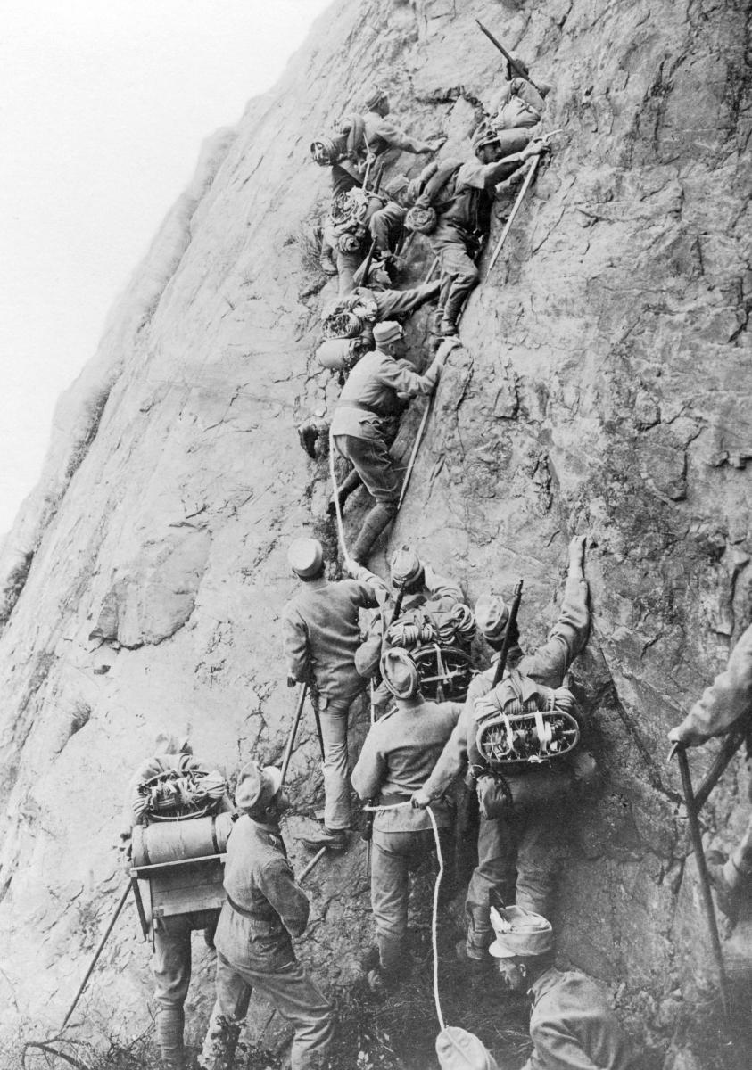 Italian alpine units climbing a steep slope during World War I